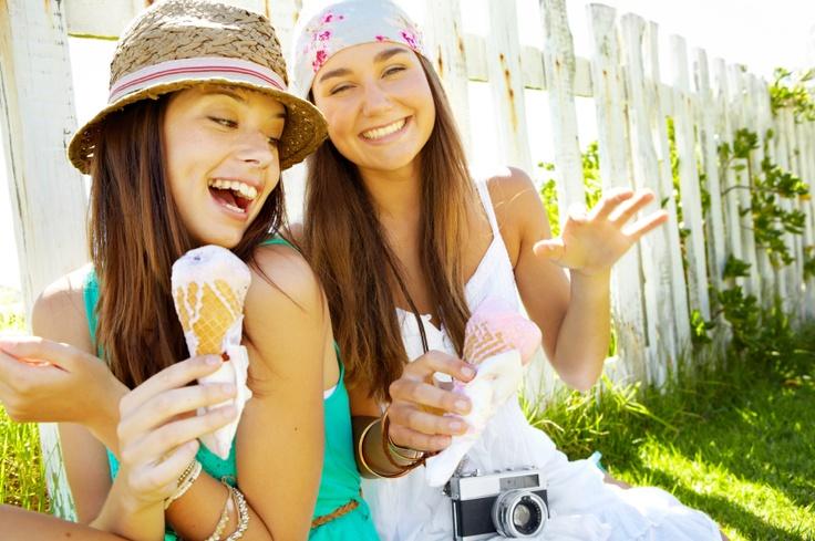 Two gorgeous women having ice cream in their garden